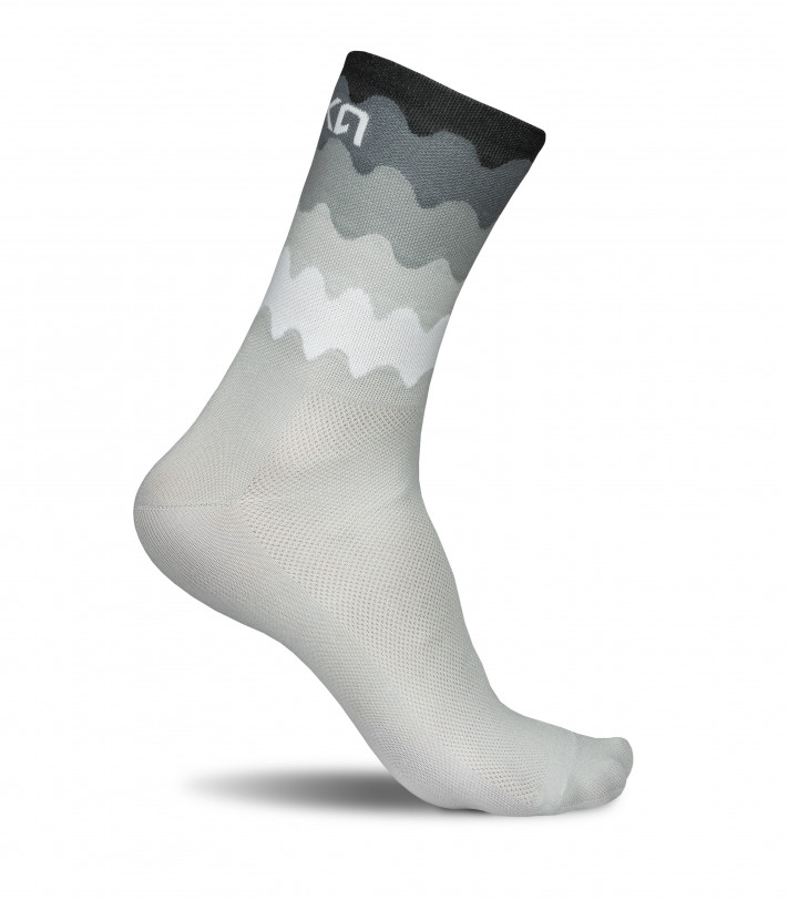 Tenerife cycling socks in black-white waves pattern.