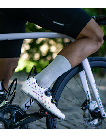 gray Luxa cycling socks on the cobbles