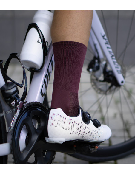 road cycling socks in burgundy / wine color on the cobbles