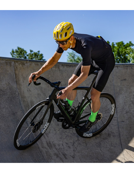 road cyclist testing fluo green Luxa socks on skatepark