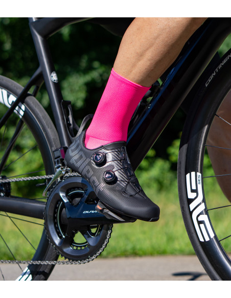 road cyclist wear fluo pink socks and riding on BMC bike
