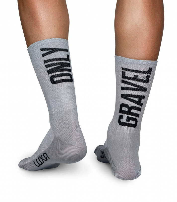 gravel cycling socks in gray color. Big caption Only Gravel on both sides