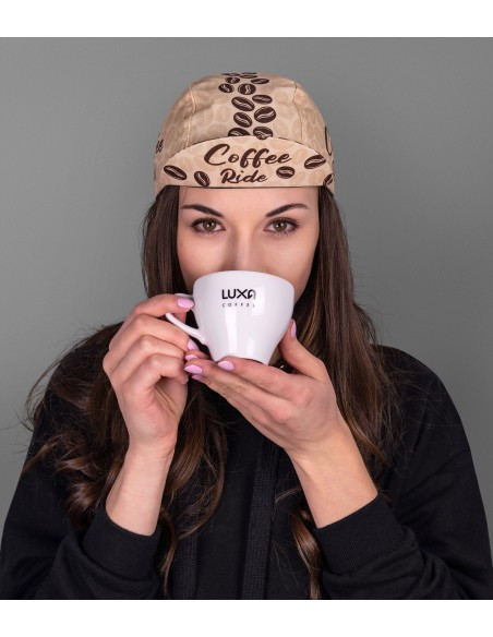 girl drinking coffee and wearing cycling cap with cafe pattern