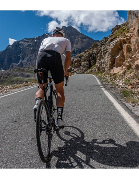 climbing to col de nivolet in italy with black 'born to climb' cycling socks made by Luxa