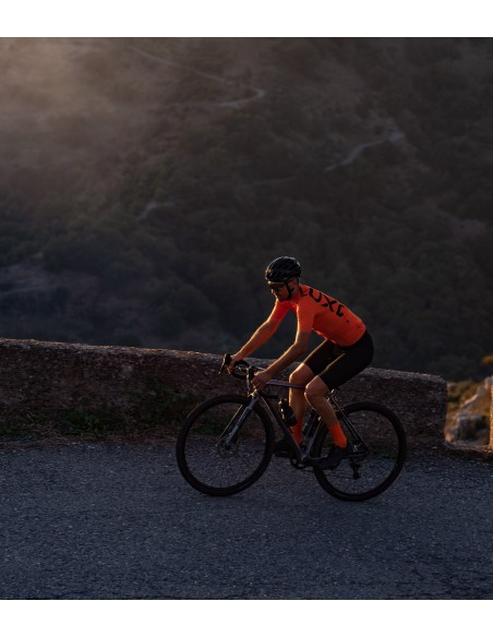 all orange cycling kit with lightweight socks. Picture was taken in Sicily (Italy) by Luxa