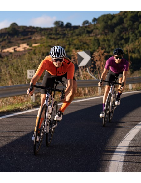 speed descending in all orange cycling kit for mens designed and manufactured in Europe (Poland)