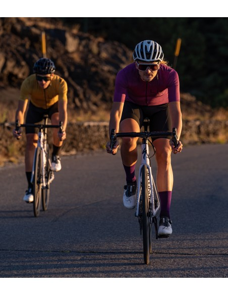 cyclist on the way around Etna volcano in Sicily wearing Luxa jerseys