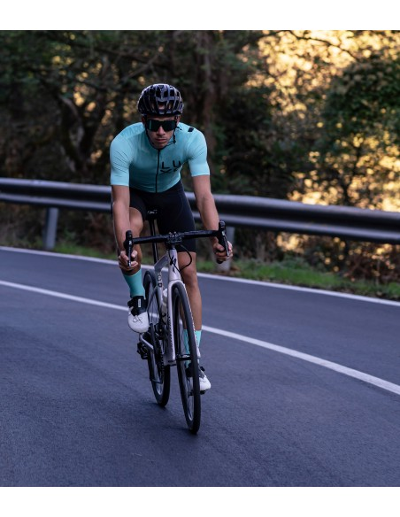 men's cycling kit with mint jersey and socks