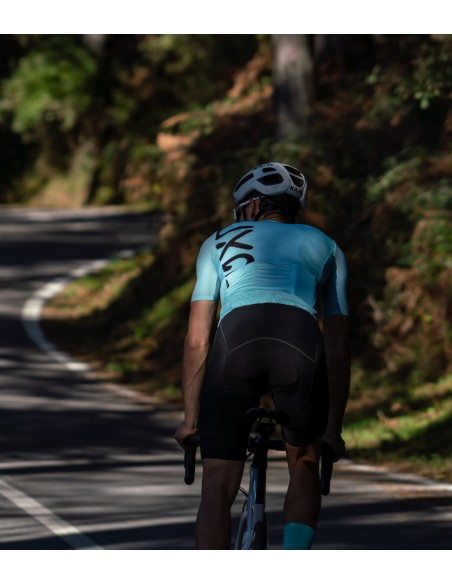 riding through the wood in Sicily with new mint cycling kit
