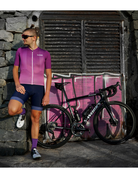 Cyclist with violet cycling kit, Specialized bikes and shoes