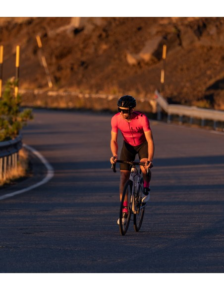 pink cycling kit for men's and photo shooting on Etna in Sicily.