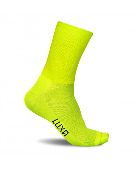 fluorescent structure of the fibers reflects the light better than traditional yarn in classic cycling socks
