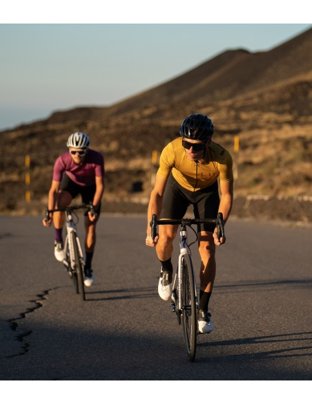 fast training ride with gold cycling kit made in europe by Luxa