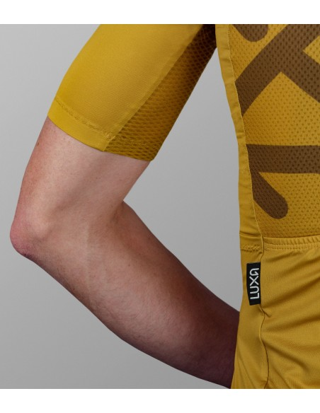 man's gold cycling apparel with breathable mesh