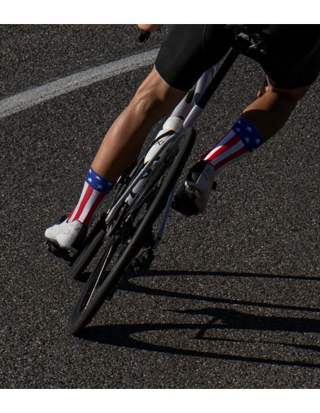 road cyclists descending and wearing USA - United States country flag socks