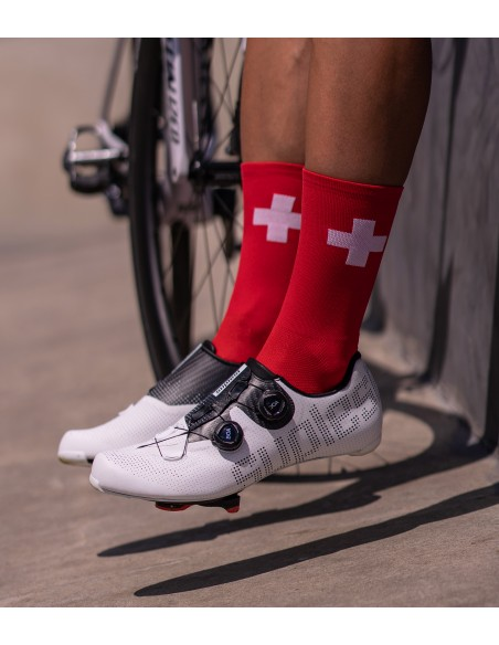 swiss cycling socks with white cross on red background and Suplest shoes from Switzerland