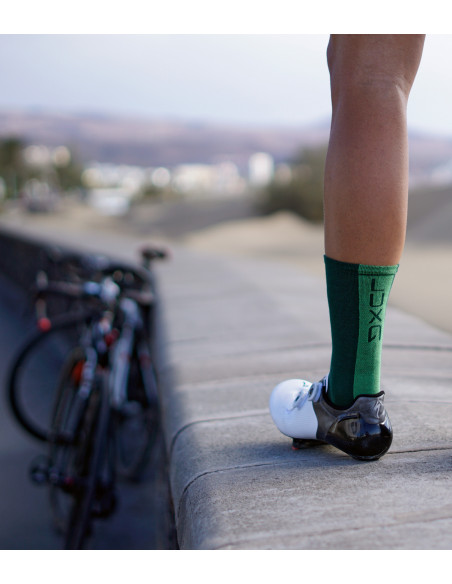 Cyclist during the break with green socks