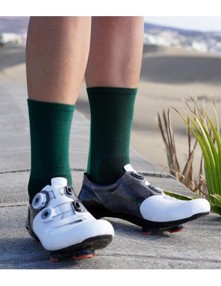 Green socks and cyclists leg