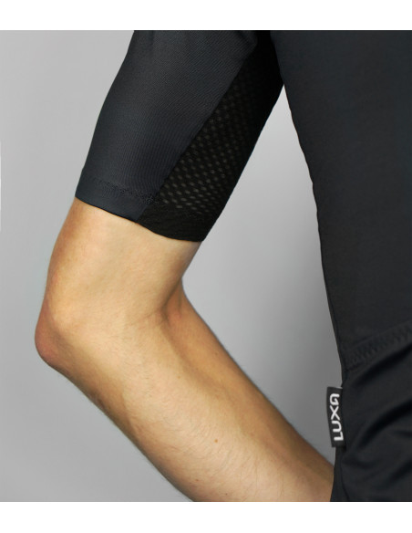 Sleeve with high-wicking mesh fabric on black Luxa cycling jersey