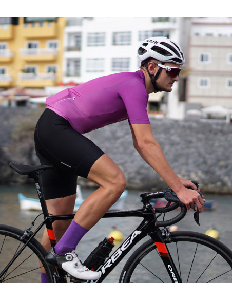 Purple cycling kit on the road. Aurora made in Europe by Luxa