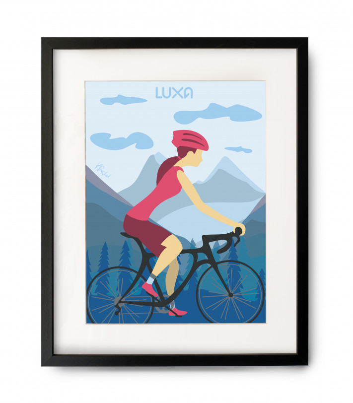 Woman riding on a road bike among the mountains.