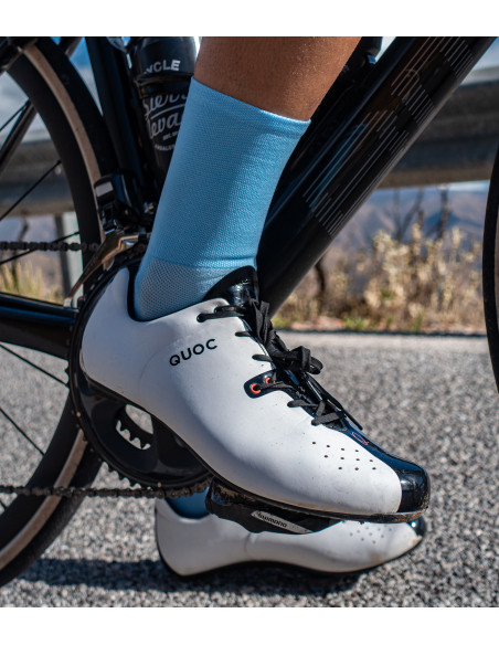 Cyclists leg with light blue color cycling sock