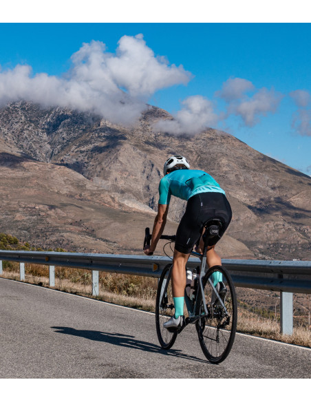 Cyclist riding in the Sierra Nevada mountains area