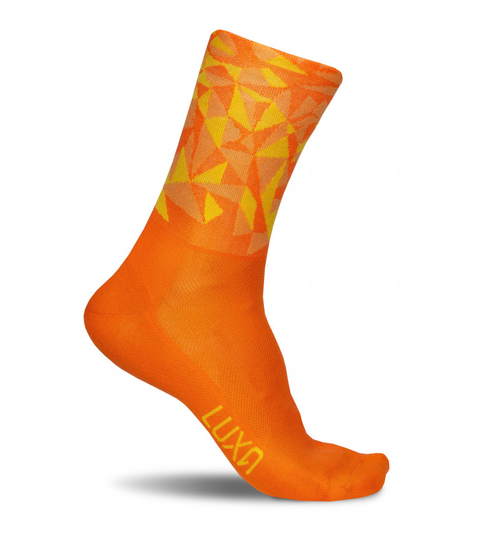Bright and saturated orange socks for performance long distance riding