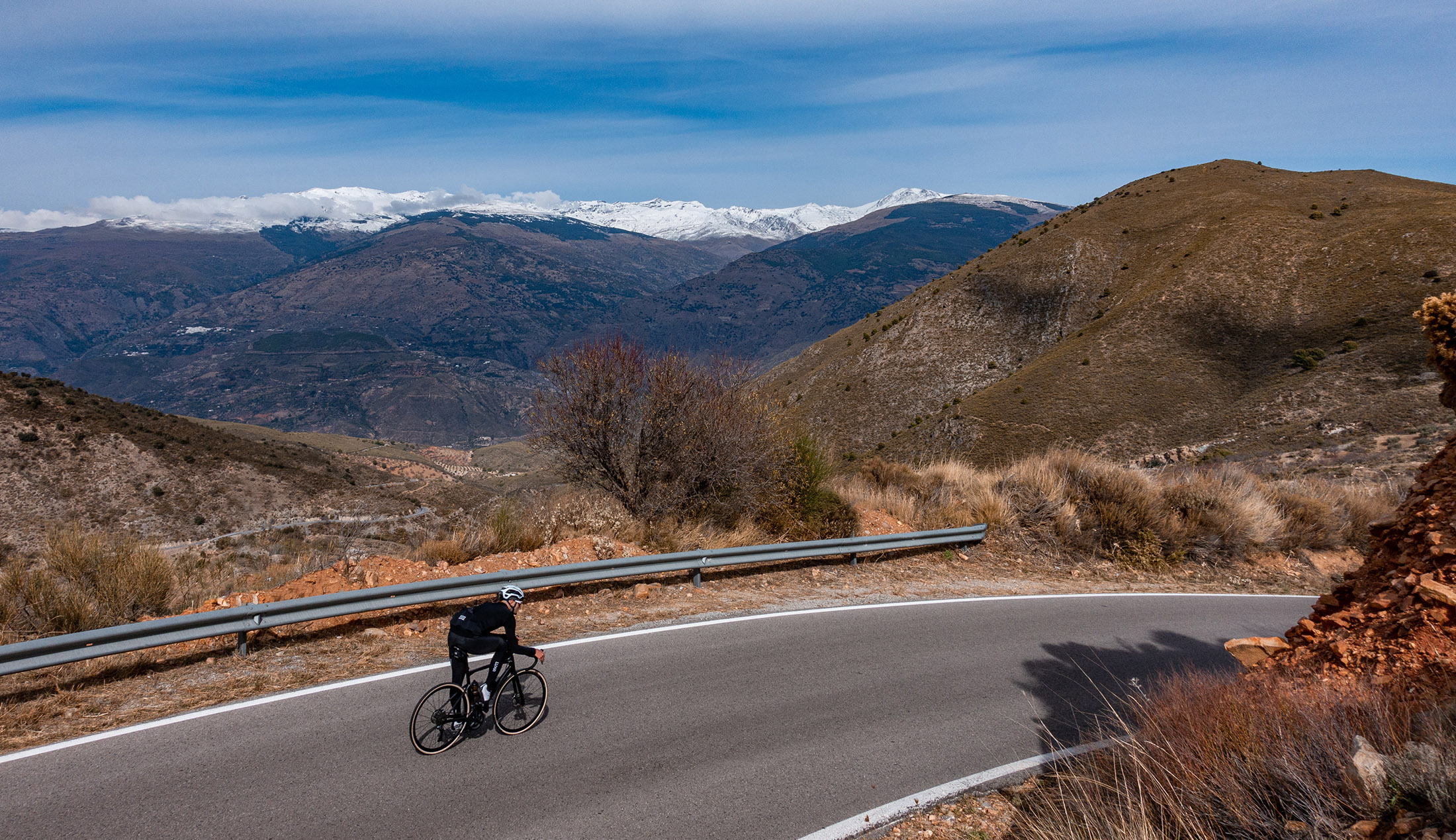 empty roads of Andalusia (Sierra Nevada) cyclist wear all black cycling luxa kit