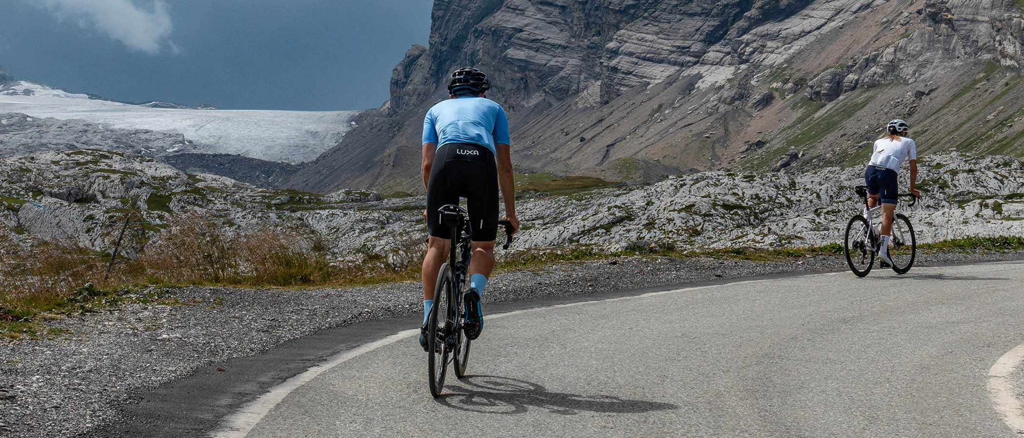 blue cycling kit tested on mountains and road male cyclist wear blue cycling socks