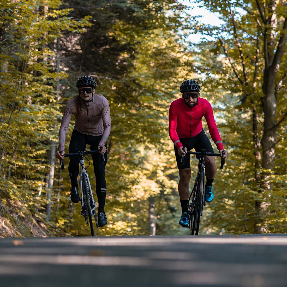 two road cycling friend are riding and wearing Autumn cycling clothing jackets
