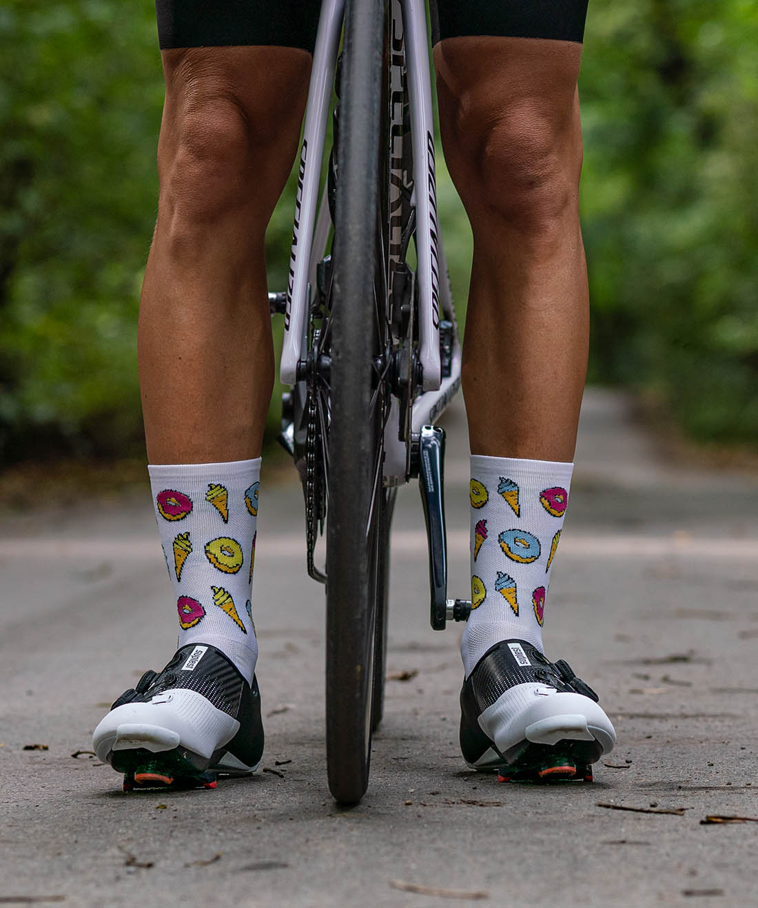funny donuts cycling socks with cookies, donuts and ice cream on white background
