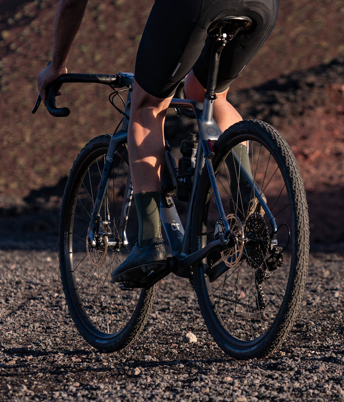 Gravel cyclists wear khaki socks to avoid dirt and stains during the ride
