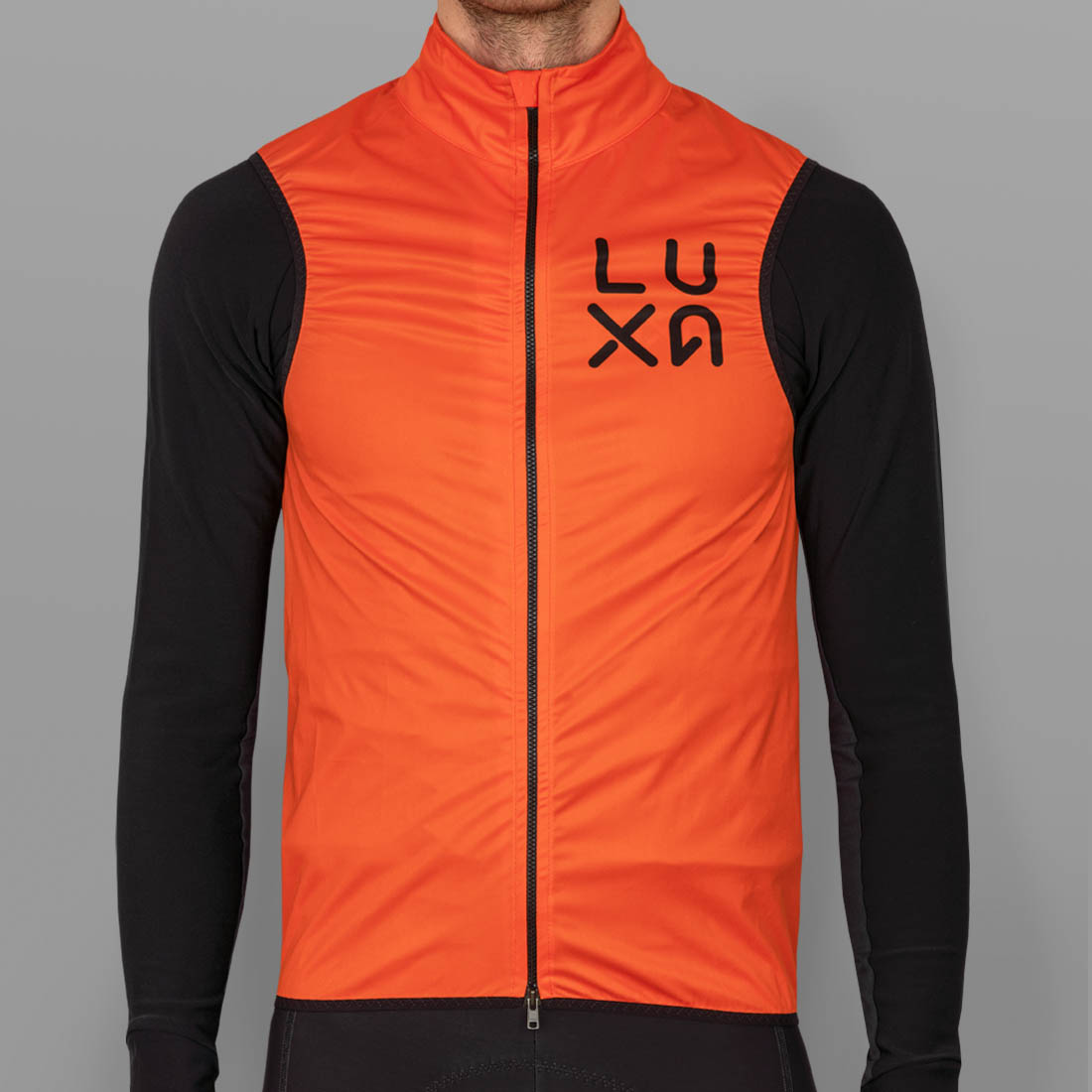 vision gilet made by Luxa in orange windproof fabric in europe