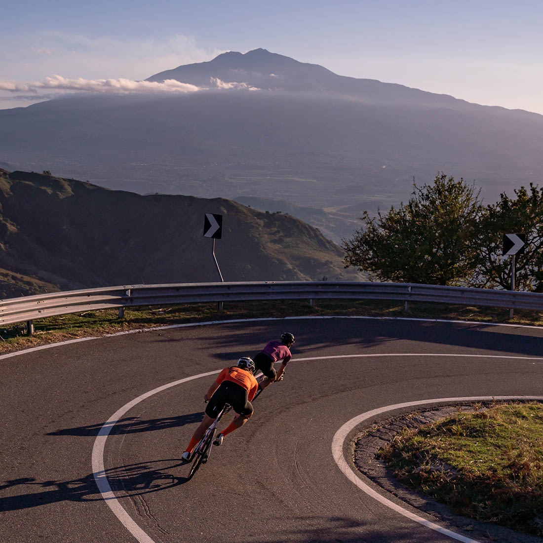 speed descending in Sicily on rad bikes and Luxa apparel (Etna volcano in the background)
