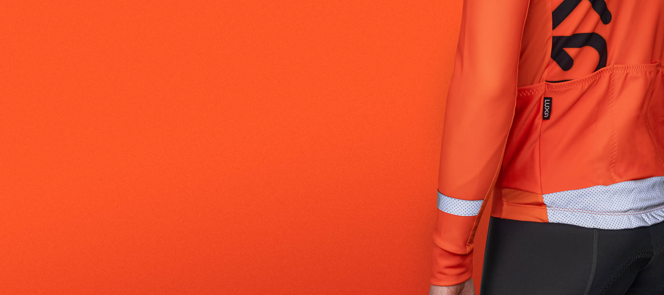 cycling apparel with high visible orange reflective colors