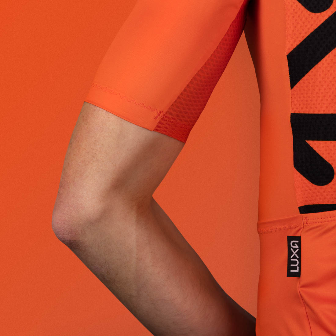 rising orange is a jersey made in europe for road cyclists