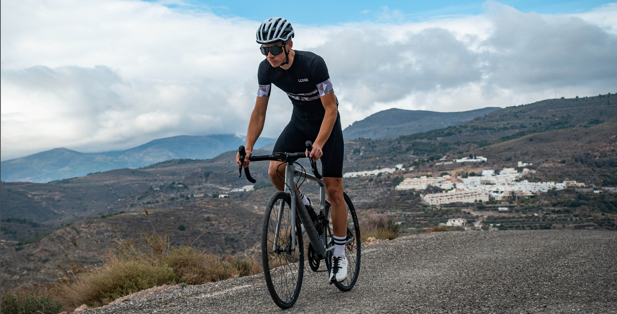 road cyclist in Andalusia wear Luxa jersey and white socks with stripes